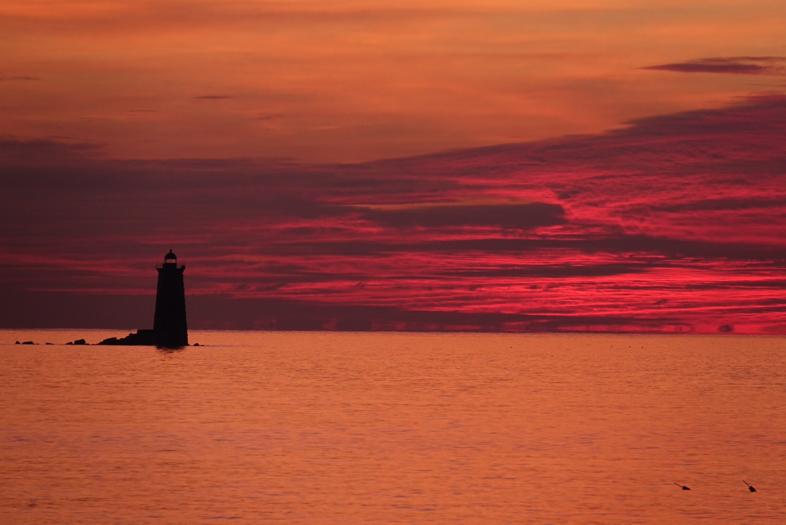 Picture of the light house surrounded by red sky