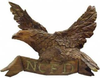 Wooden Eagle with Letters NCFD on it